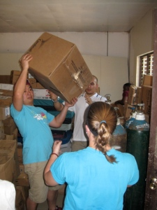 WSF Volunteers unload donated supplies from storage to the hospital