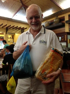 Plastic Surgeon Dr. David Leber receives gift of chicken and bread from a patient